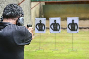 Man hold a gun aiming ready to shoot.