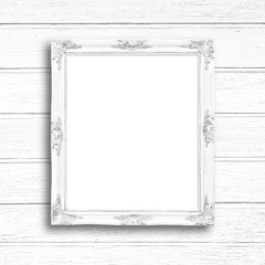 Classic white blank picture frame on white wood wall.