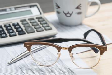 Eyeglasses on business desks