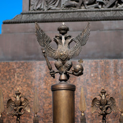 The double-headed eagle on the fence of the Alexander Column in front of the Winter Palace. Russia. Petersburg.