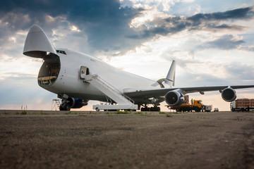 Fototapeta Unloading wide body cargo airplane