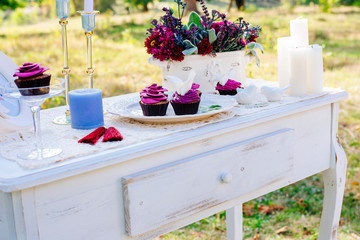 The decor at the wedding. With the cupcakes in the shape of flowers
