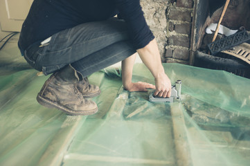 Young woman insulating floor