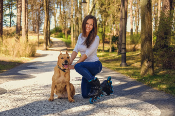 Attractive brunette female posing with her dog.