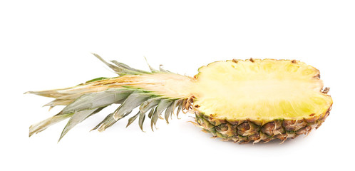 Cut pineapple isolated over white background