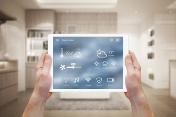 Smart home control on tablet. Interior of living room in the background.