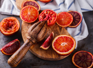 blood orange,freshly squeezed orange juice,on a wooden Board.selective focus.