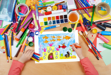 castle under water with treasure, the king fish with crown, fairy tale, child drawing, top view hands with pencil painting picture on paper, artwork workplace