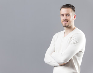 Portrait of a handsome young man on grey background
