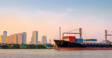 Cargo ship was sailing from the river toward the Gulf of Thailand in the evening.