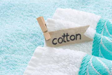 Stack of bath towels with cotton lettering