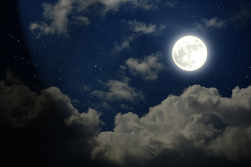 Beautiful starry night sky with clouds and moon