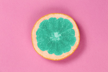 Top view popart grapefruit green color on a pink background. Grapefruit in the style of pop art in the center of the frame. Bright fruit grapefruit.
