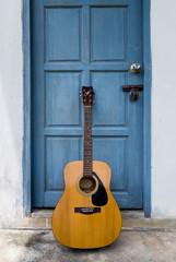 Guitar on vintage door