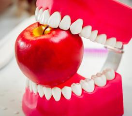 Dentures biting an apple