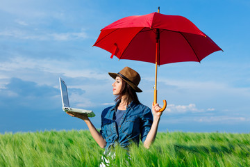 young woman with umbrella and laptop