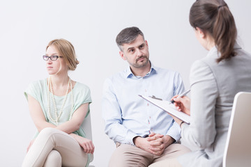 Young woman and man on psychotherapy
