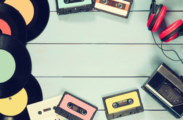 top view of cassette, headphones, records and old tape playe