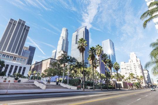 road before modern office buildings in los angeles