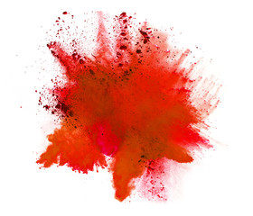 Explosion of orange powder on white background