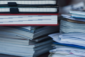 Accounting and taxes. Pile of magazine, notebook and books close