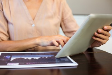 Cropped image of businesswoman using digital tablet