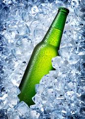 Green bottle in ice