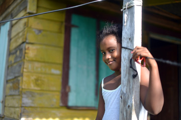 native Nicaraguan girl smiling  clapboard house Big Corn Island