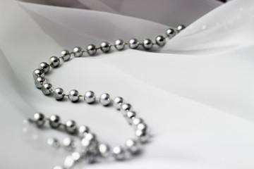 Beads on white textile