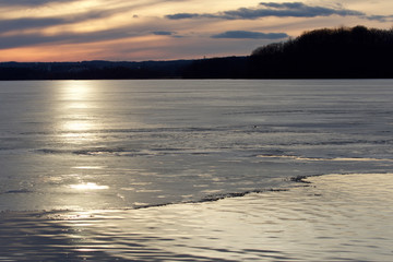 Image with a beautiful sunset on the icy lake