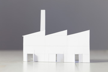 little world,paper art diorama, white factory in a white and gray background