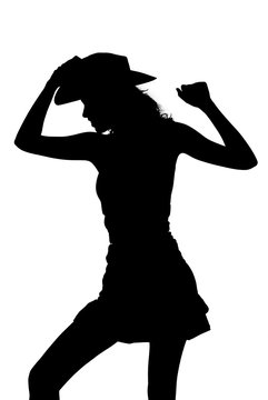 silhouette of a cowgirl dancing and posing