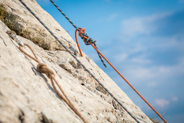 Climbing rope knot on stone wall