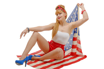 Sexy pin up girl  holding an American flag.