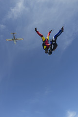 Team of two female skydivers in head down position over Buttwil, Luzern, Switzerland