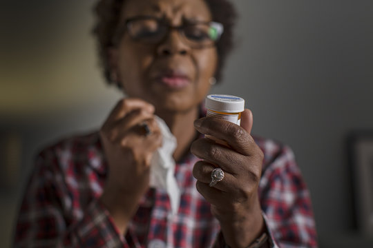 Mature woman with cold reading label on medication