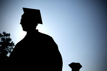 graduate walks during commencement ceremony.