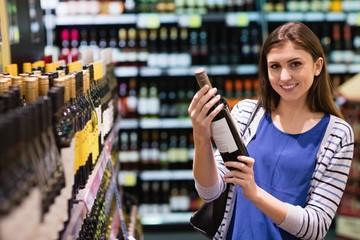 Woman holding a wine bottle