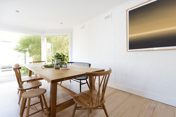 Scandinavian styled dining room interior with contemporary artwo