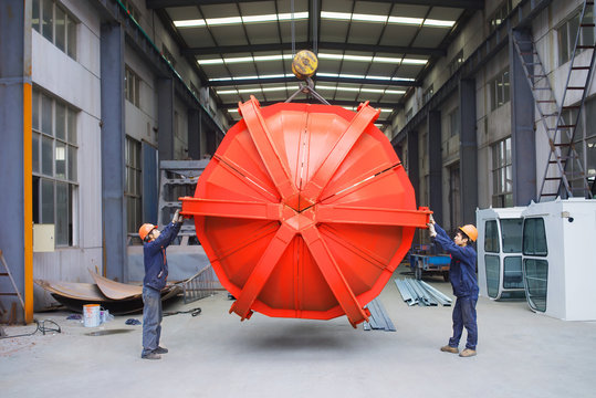 Workers working together in crane manufacturing facility