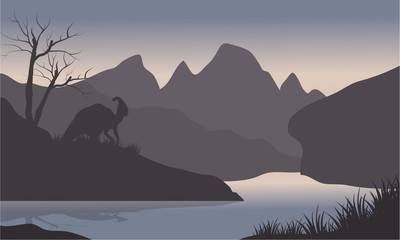 Silhouette of parasaurolophus in riverbank
