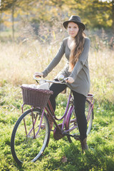 Young woman wearing hat on bicycle