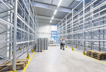 Businessmen meeting in empty factory warehouse