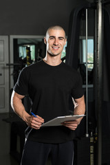 Personal Trainer With Clipboards