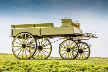 A uncovered wagon retro style in beautiful nature scene farmland