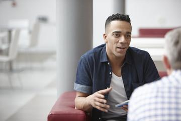 Businessmen meeting on office sofas