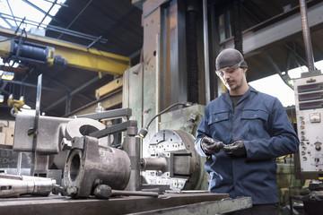 Man working in metal workshop