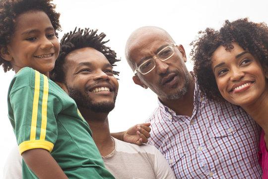 Grandfather and family at Ipanema Beach, Rio De Janeiro, Brazil