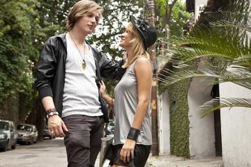 Young couple chatting on street, Rio De Janeiro, Brazil