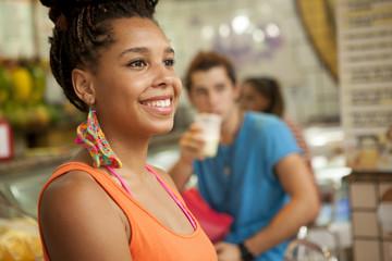 Young tourist friends drinking juice at juice bar, Copacabana town, Rio De Janeiro, Brazil